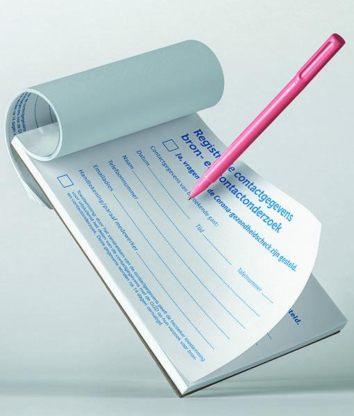Corona registratie formulieren in schrijfbloks